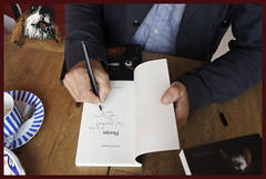 "Ernst Timmer is signing his book ""Florijn""and  Florijn's little dog Nero is awaiting a herring or two..as a reward of being patient. (Maria Emanuela) Tags: florijn thelittledoglaughed maaikeputmanillustrator ernsttimmer prometheusflorijn neroflorijnernsttimmer florijnillustrationmaaikeputman florijnernsttimmerprometheusamsterdam collectorsitemprometheusamsterdam maaikeputmanillustratorflorijn maaikeputmaneu"
