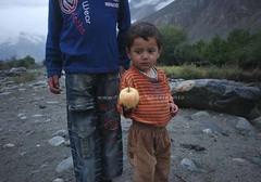 A big apple (Ameer Hamza) Tags: pakistan boy 2 two mountains apple fruit big district photojournalism fresh local dist 2011 ghizer ghizar mujawar mujavar boyofferingapple