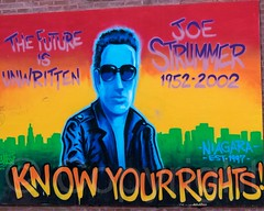 JOE STRUMMER Tribute Mural (2013) by Dr. Revolt and Zephyr, East Village, Lower Manhattan, New York City (jag9889) Tags: nyc newyorkcity usa streetart eastvillage ny newyork art graffiti mural memorial artist unitedstates rockstar manhattan unitedstatesofamerica streetphotography singer tribute publicart lowermanhattan alphabetcity theclash joestrummer 2014 niagarabar knowyourrights thefutureisunwritten jag9889