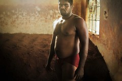 Indian mud wrestlers (fredcan) Tags: travel school light portrait india man window sports muscles pose mud body earth indian shade walls tradition karnataka mysore fit southindia southasia akhara kushti indiansubcontinent kusti fredcan indianmudwrestler