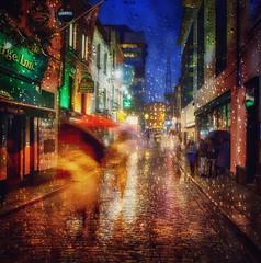 Walking in the rain (janetmeehan) Tags: dusk bluehour people reflections movement rainy raindrops rain city streetphotography streetscene street ireland dublin