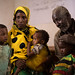 Halima Abdi Awbashir, 25 feeding supplementary food her malnourished two children, Shiki Osman 2 and Muktar Osman 3.