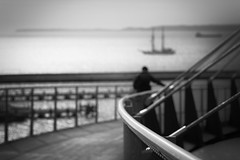 Man, Sea and Architecture (stephanie_ruebenach) Tags: canon black white schwarzweis sassnitz rgen deutschland germany human element silhouette sea meer baltic ostsee ship schiff bridge brcke architecture architektur
