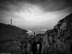 Cabo Home (Guillermo Carballa) Tags: ligthouse sky sea water bw man people alone light