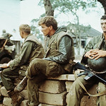 Hue 1968 -  Young U.S. Marines sit sad-faced and idle for a moment during pause in fighting - Photo - by Dana Stone thumbnail