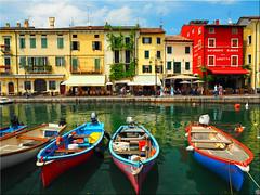 The wonderful  port of Lazise on Lago di Garda (Ostseetroll) Tags: geo:lat=4550512158 geo:lon=1073195208 geotagged ita italien lagodigarda lazise veneto boote fischerboote boats fishingboats italia italy gardasee hafen port spiegelungen reflections