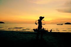seller going home on the beach (hatschiputh) Tags: otres beach sunset water seller sky