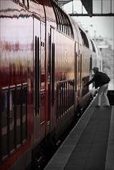 Hurry up! (Gabi Wi) Tags: bahnhof bahnsteig zug person reise farbverlauf tren rot schrfespiel spiegelung