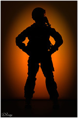 Fighter Pilot (Donna Rowley) Tags: flickrfriday silhouette pilot plane sunset sunrise orange vignette man stance