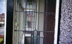 img240 (foundin_a_attic) Tags: april 1973 street houses homes fashion eveyday life england suburbs window stainglass