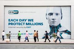(Dubai Jeffrey) Tags: man dubai worldtradecenter uae pedestrian streetscene billboard sheikhzayedroad eset