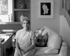 Angel of Empathy (koni-omegaman) Tags: portrait blackandwhite woman with kodak 14 15 4x5 f56 ilford fp4 ektar ddx 2013 ei80 9minutes gowland 152mm pocketview rotarydrum