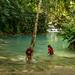 Girls bathing at the Kuang Si falls near Luang Prabang, Laos