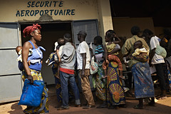 Central African Republic: Torn Apart by Violence (UNHCR Photo Download) Tags: africa woman man car airport child dusk