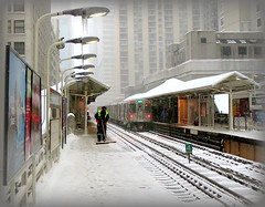 Shoveling the platform (yooperann) Tags: winter snow chicago man green ice train day cta authority platform el line transit elevated now icicles employee shoveling sweeping chicagoist chiberia