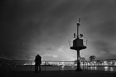 Love in the sea (jordisi82) Tags: barcelona sea people blackandwhite bw mer lighthouse love port canon faro mar gente noiretblanc catalonia bn personas amour catalunya gent far phare catalua badalona canon6d
