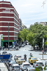 A street in Athens... (Alex Gartzo) Tags: road street trees sky streets building tree cars car sign buildings taxi athens taxis greece roads