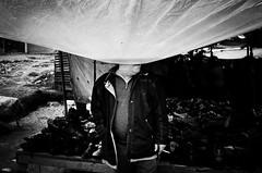 IMGP8138-stavrosstam (stavrosstam) Tags: street man face rain market tarpaulins