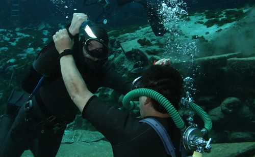 Double knife fight in vintage scuba diving wetsuit gear - a photo ...