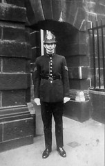 Circa 1974. Metropolitan Police Sergeant Richard Bott Pictured Outside Cannon Row Police Station, (Alpha Delta) Westminster, London, SW1. UK. The Building In The Rear Is Scotland Yard Designed By Famous Scottish Architect Norman Shaw. (sgterniebilko) Tags: metropolitanpolice cannonrowpolicestation westminster london sw alphadelta ad 1974 1970s 70s londonpolice policelondon aorwhitehalldivision