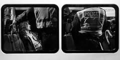A Long Night Ahead - Explored (Sean Batten) Tags: millionmaskmarch london england unitedkingdom gb blackandwhite bw streetphotography street nikon df 50mm police policeman van policevan windows