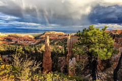 Disappearance (KPortin) Tags: brycecanyonnationalpark weather rainbow rain utah hoodoo fairylandcanyon mesa pinnacle clouds sunset hiking trees geology
