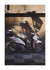 Represent (icypics) Tags: czechrepublic grafiti prague stilllife streetphotography texture urban bike lampost moped motorcycle shadows