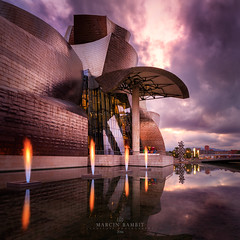 Guggenheim Museum (Marcin Bambit) Tags: spain bilbao guggenheim museum architecture cityscape sky dramatic clouds sunset
