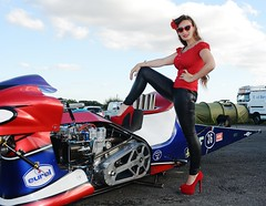Holly_9847 (Fast an' Bulbous) Tags: top fuel bike motorcycle eurol sharkattack biker chick babe girl woman pinup model long brunette hair tight leather pvc leggings jeans red shoes high heels stilettos drag race strip track pits santa pod england eurofinals people outdoor pose nitro
