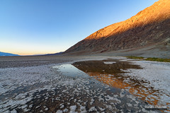 The Lowest Sunset (kevin-palmer) Tags: deathvalley deathvalleynationalpark nationalpark california mojavedesert badwaterbasin saltflats salty hot clear blue sky sunny sunshine sunset evening nikond750 november fall autumn tokina1628mmf28 water pool reflection mountains