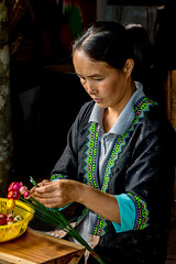 Hmong woman making flowers (maryannenelson) Tags: thailand hmong women tradition people culture