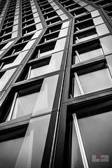 Hamburg Building (tschischek) Tags: blackandwhite skyscraper squares architecture lines view nikon d610 nikond610 fullframe hamburg travel city german germany glass building window windows reflexion