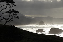 Cannon Beach (Andy Ziegler) Tags: beach cannonbeach oregon silhouette shoreline seashore water waves haystackrock monolith pacificnorthwest seastack tourism travel backlighting nature picturesque beautiful magical landscape canon6d mountains