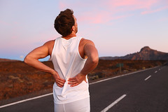 Back pain - Athletic running man with injury (sammy_ashrafi) Tags: back backache running runner ache pain sport accident problem sore injury muscle painful exercise athlete jogger jogging male runners sports athletic backpain chronic fitness healthy lower massaging problems spinaldischerniation spine sportswear summer workout young arthritis body health injured injuries man medical muscles muscular people person physical road sprain training guy unitedstatesofamerica