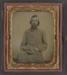 [Unidentified private in Confederate uniform]  (LOC) (The Library of Congress) Tags: portrait man private beard uniform case confederate libraryofcongress handcolored 1860s seated xmlns:dc=httppurlorgdcelements11 dc:identifier=httphdllocgovlocpnpppmsca34332