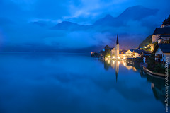 Hallstatt (baddoguy) Tags: city morning travel light wallpaper mountain reflection classic nature horizontal austria countryside twilight community cityscape village cloudy peaceful tranquility atmosphere nopeople landmark images getty destination copyspace stillwater iconic civilisation gettyimages hallstatt colorimage gettyimagesstock