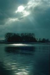 winter sun (Paula Roy) Tags: winter sun canon 50mm kodak ae1 teal sunbeams bluegreen ladscape portra400