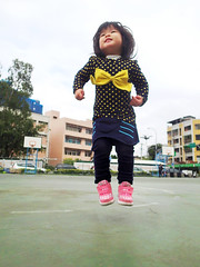 Jumping Zorie (Zorie Huang) Tags: morning pink light portrait baby cute girl smile naughty asian kid jump infant child innocent taiwan olympus nike bow lovely taiwanese basketballcourt twoyearold streetsnap nikesneakers tg2 zorie olympustg2