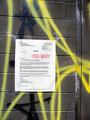 Legal Notice (knightbefore_99) Tags: street city yellow wall vancouver graffiti notice fine decoration threat eastvan bureaucrat leagal