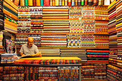 The rug merchant (Lucio Busa) Tags: istanbul streetphotography gran bazar mercato market olympus em5 omd travel turkish turchia man people rug