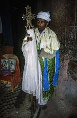 Biete Meskel priest, 1998 (NettyA) Tags: 1998 35mm canoneos500 ethiopia lalibela film scannedslide slide bietemeskel church priest cross houseofthecross orthodox