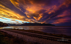Other side of the tracks (Traylor Photography) Tags: alaska canvas sunrise mudflats mountains tracks clouds surreal reflection inlet turnagainarm distance train dramatic colors sky sewardhighway kenaipenisula cookinlet railroad anchorage unitedstates us