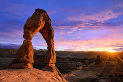 Delicate arch at sunset moment (wisanuboonrawd) Tags: america arch arches beautiful beauty canyon clear dawn delicate desert dry dusk erosion famous formation geology hiking hill huge landmark landscape moab mountain national natural nature orange outdoor park place red rock sand sandstone scenic sky slick southwest stone sunrise sunset symbol tourism travel usa utah vacation west wilderness