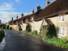 Thatched cottages, Moreton (pefkosmad) Tags: buildings architecture old housing dorset england uk cottages terrace thatched roof quaint moreton village row