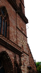 Basel-2016_09 (rhomboederrippel) Tags: rhomboederrippel 2016 fujifilm xe1 switzerland basel citycentre citycenter historic church minster baslermnster maingate sundial clock gothic red sandstone