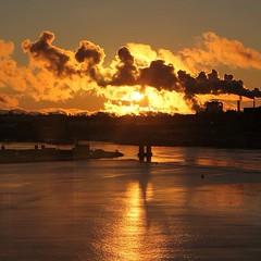 Sunset (lara_mckki) Tags: sunset harbour harbor smoke clouds river sun sunlight bridge newbrunswick canada water sky waterside dusk ocean shore landscape