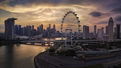 Big Dreams (Mabmy) Tags: singapore city cityscape singaporeflyer marinabaysands mbs marinabay mbfc architecture buildings sunset evening golden