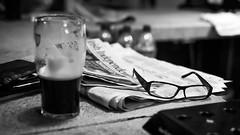 Irish pub - Dublin, Ireland - Black and white photography (Giuseppe Milo (www.pixael.com)) Tags: guinness calm print newspaper contrast monochrome photography life bw wallart white photo bokeh tranquil prints ireland blackandwhite black fineart beer canvas drink photograph dailylife pub peaceful depth city dublin irish glasses europe horizontal urban onsale