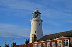 Southwold Lighthouse (DaveJC90) Tags: suffolk southwold pier souhtwoldpier building old classic wood metal lighthouse sea water northsea long exposure autumn winter sunrise sunset sun sunny sunlight light bright night sky blue cloud cloudy dark shadow beach bay hut huts reflection wave waves move movement colour colours crop croped nikon d5100 digital slr camera wide angle zoom lens 1020mm 1855mm detail sharp sharpness