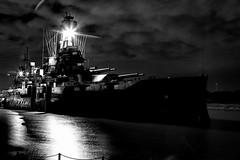 Imposing (Scott Sanford) Tags: nightphotography night lowlight texas texashistory water reflections outdoor battleshiptexas clouds sky blackandwhite bw monochrome canon eos topazlabs 6d ef2470mmf28lusm